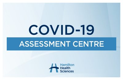 """A sign reads """"COVID-19 Assessment Centre"""""""